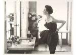 Dorian Leigh, Evening Dress by Piguet, Helena Rubinstein Apartment, Ile Saint-Louis, Paris, August 1949 by Richard Avedon, 1949